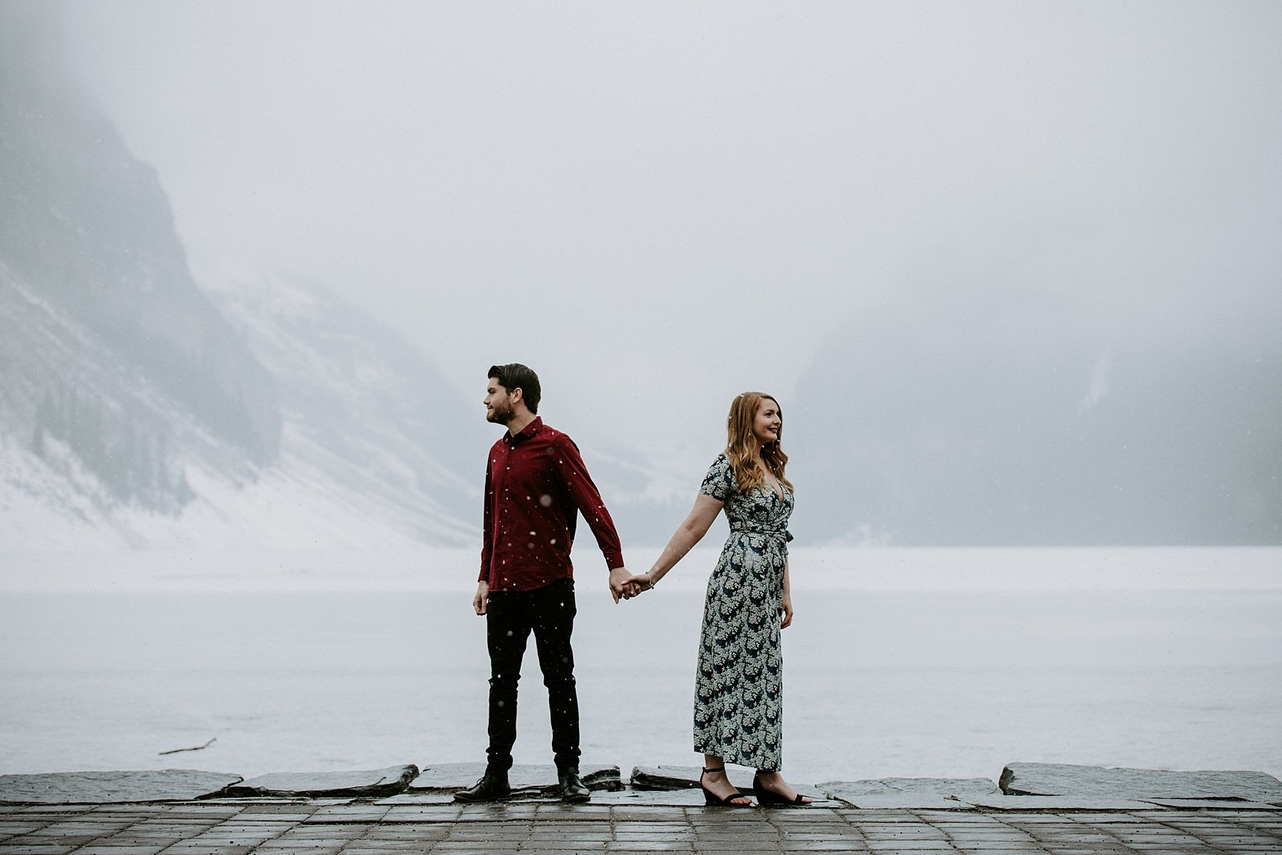 Lake louise engagement photos in front of the lake