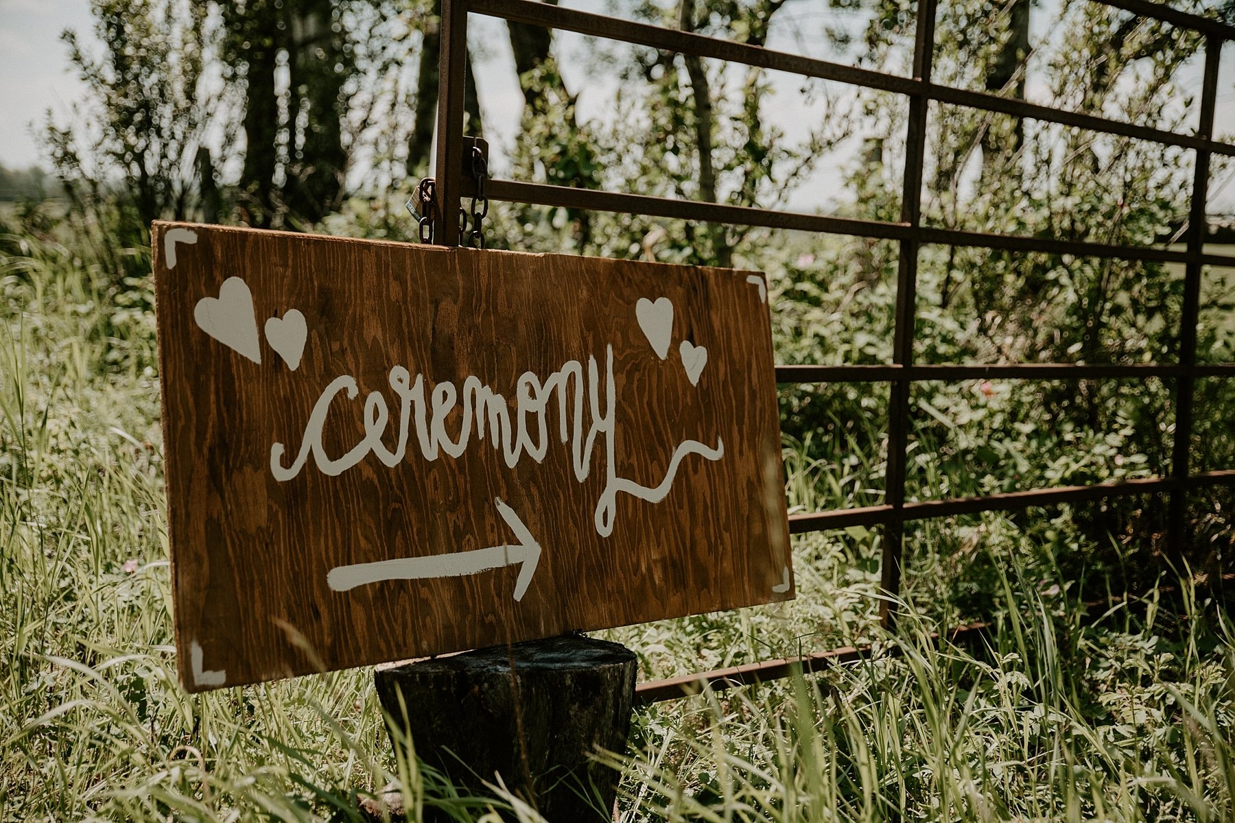 outdoor rustic ceremony sign