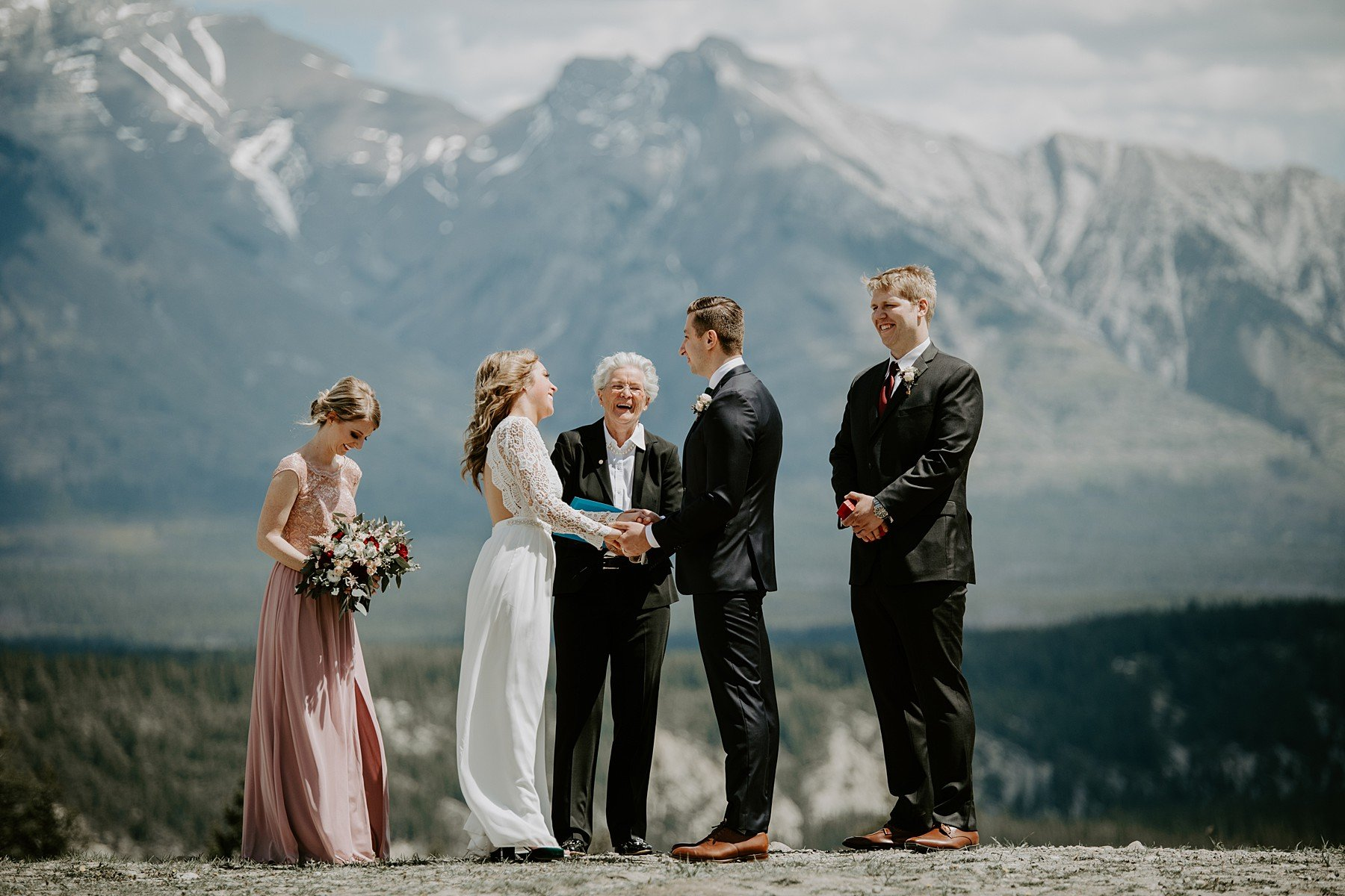Bride wearing Lulus wedding dress during her Banff Elopement ceremony at Tunnel Mountain